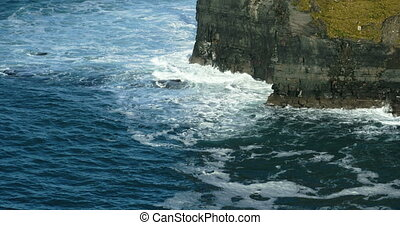 Wave breaking against cliff