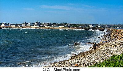 Wave Crash Stony Beach Westport Point Massachusetts Buzzards Bay Atlantic Ocean. Waves crashing on rocks, spray