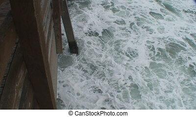 Wave Crashing on Pier - Hd 1080 High angle shot of a large...