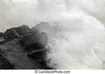 Wave crashing over cliff
