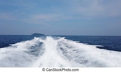 Wave from cruise boat on water surface, sun light and...