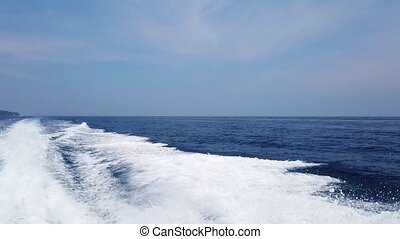 Wave from cruise boat on water surface, sun light and ...