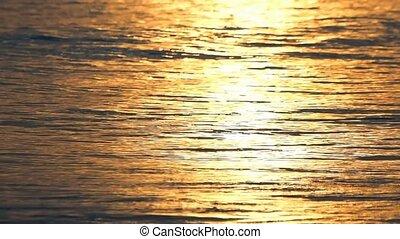 wave golden hour at sunset