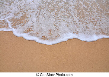 wave of sea on the sandy beach