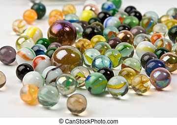 Wave of spilled colorful glass marbles - A wave of spilled...
