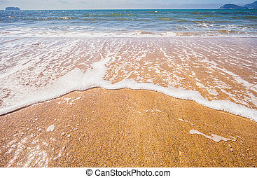 Wave of the sea on sandy beach