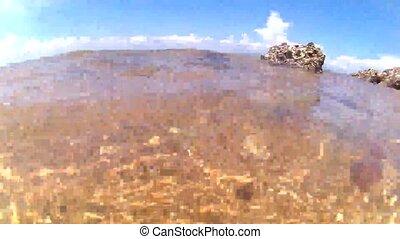 Wave on rock beach