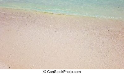 Wave on white sand beach - Wave with white foam on white...