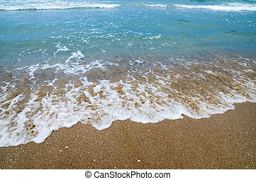 Wave - The wave surges on sandy coast