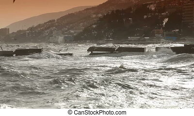 Wave smashing - Storm Waves Smashing Against Water Brekers....
