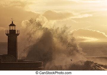 Wave splash at orange sunset