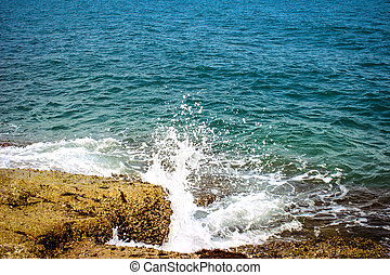 Wave splash in the sea at rock