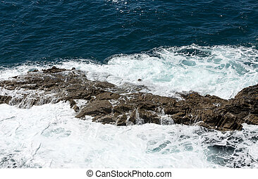 Wave splashing over a rock on Caleta Negra beach in Ajuy  on Fuerteventura. Canary Island, Spain