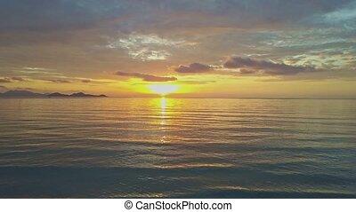 Wave Surf on Serene Ocean Beach Sun Rises above Horizon