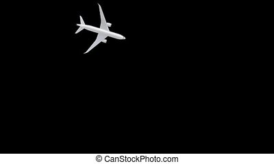 Computer graphics of the undulating flight path of an airplane on a black background