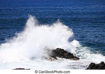 Waves against a cliff