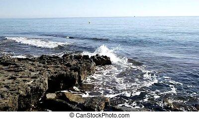 Waves against Rocks - Waves wash against Rocks on Med. shore
