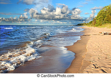 Waves along the beach of Lake Superior in northern Michigan under beautiful sunlight.