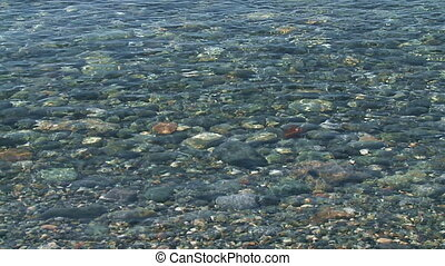 Waves and pebbles   - Waves softly lap over pebbles