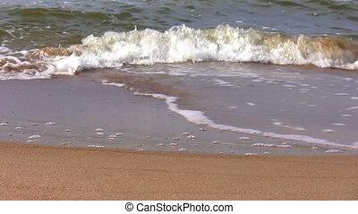 Waves and sand beach