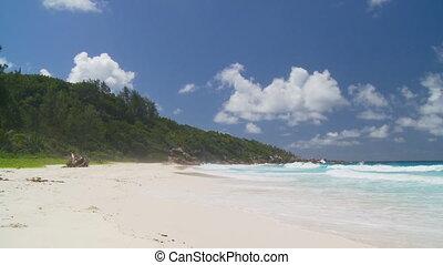 waves and spume on sandy beach - wonderful waves meeting...