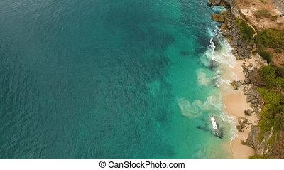 Waves and stony beach. Aerial view. - Waves of the Indian...