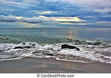 Waves Around Rock Jetty at Sunrise
