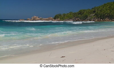 waves arriving at island - beautiful whitecaps arriving on...