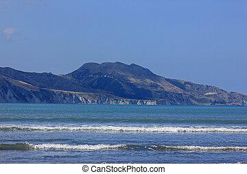 waves at mahia beach on a sunny day