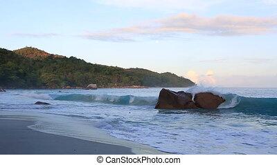 Waves at sunrise on the beach Anse Lazio.