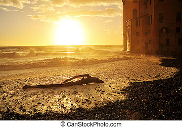 waves at sunset on the waterfront town of Camogli