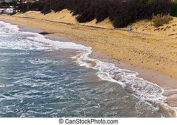 waves at the sandy beach