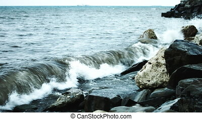 Waves beat against the rocks on the shore