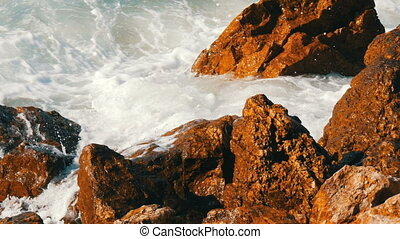 Waves beat against the rocky shore. Beautiful waves of the South China Sea close up view