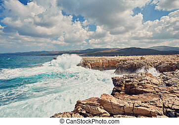 Waves beat on the rocky shore, Mediterranean Sea.