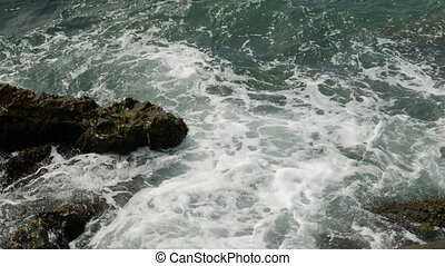 waves beating on the rocks on the beach in Montenegro Herceg...