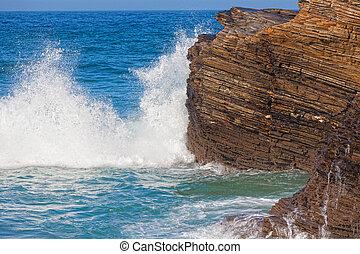 Waves break about rocks, the Atlantic Ocean at the coast of ...