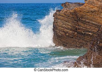 Waves break about rocks, the Atlantic Ocean at the coast of...