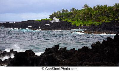 Waves Break Against Volcanic Rocks in Maui, Hawaii