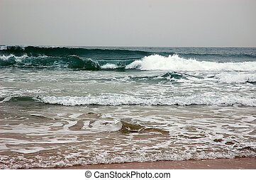 Waves break on shore in bad weather