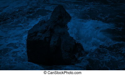 Waves Break Over Rock In The Sea At Night - Large ocean...