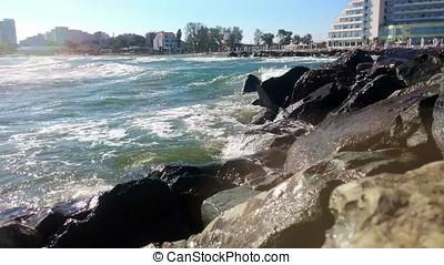 Waves breaking on rock shore, Constanta beach, Romania