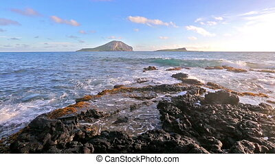 waves breaking on rocks close to Macapuu beach, Oahu, Hawaii...