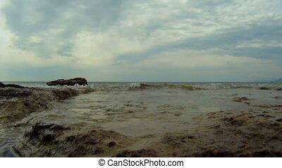 Waves breaking on rocks - Ocean waves rolled on a rocky...