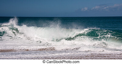 Waves breaking on sandy beach