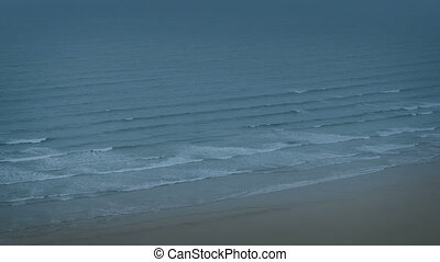 Waves Breaking On Shore In The Evening - Calm sea shore with...