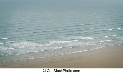 Waves Breaking On Shore Vista - Calm sea shore with waves...