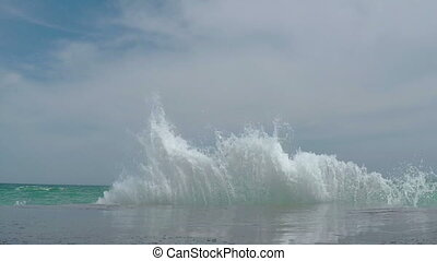 Waves Breaking on the Breakwater