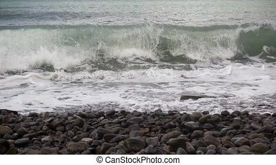 Waves breaking on the rocks slow mo