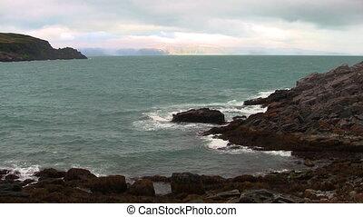 waves breaking on the rocks
